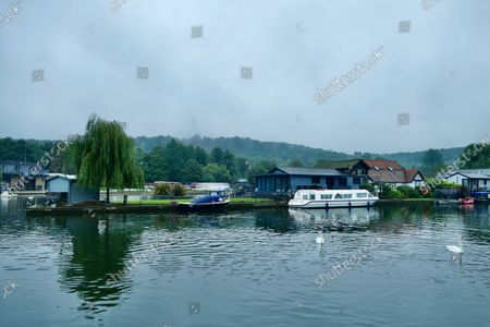 Residents of a river island in Henley are upset at plans to charge them a mooring fee.Henley Town Council is proposing to introduce a permit costing £290 per year, or £145 for six months, for people living on Rod Eyot to moor their boats at Mill and Marsh Meadows outside the hours of 10am and 3pm.This compares with visitors who pay £10 per day or £55 for a week with a maximum stay of 14 days.Until now, the islanders are meant to have paid the daily fee when they used the moorings but this hasn't been enforced.Now the council has hired a specialist company to enforce the charges with regular checks and fines for anyone in breach of the conditions.