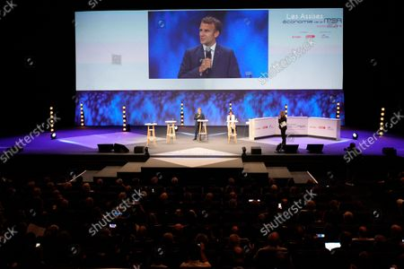 French President Emmanuel Macron, left on stage, and Minister for the Sea Annick Girardin attend the Sea Economy meeting in Nice, southern France