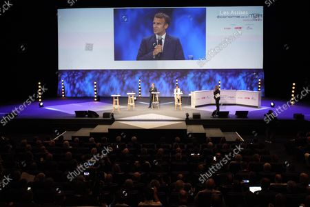 French President Emmanuel Macron (C) and Minister for the Sea Annick Girardin (C-R) attend the Forum of the Economy of the Sea in Nice, southern France, 14 September 2021. The two-day event runs through 15 September.