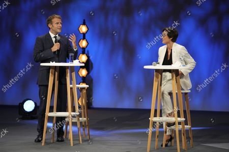 French President Emmanuel Macron (L) and Minister for the Sea Annick Girardin (R) attend the Forum of the Economy of the Sea in Nice, southern France, 14 September 2021. The two-day event runs through 15 September.