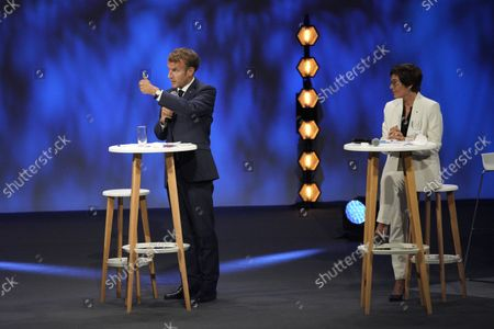French President Emmanuel Macron (L) and Minister for the Sea Annick Girardin attend the Forum of the Economy of the Sea in Nice, southern France, 14 September 2021. The two-day event runs through 15 September.