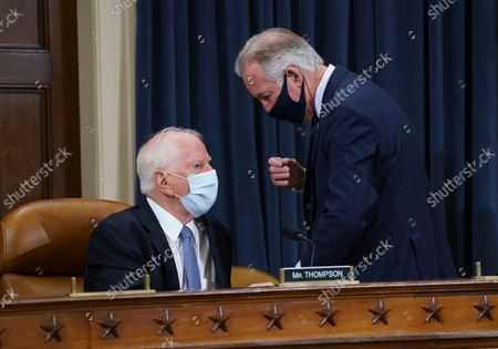 Stock Picture of Rep. Mike Thompson, D-Calif., left, confers with House Ways and Means Committee Chairman Richard Neal, D-Mass., as the tax-writing panel continues work on a sweeping proposal for tax hikes on big corporations and the wealthy to fund President Joe Biden's $3.5 trillion domestic rebuilding plan, at the Capitol in Washington