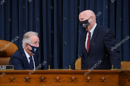 House Ways and Means Committee Chairman Richard Neal, D-Mass.,left, and Rep. Kevin Brady, R-Texas, the ranking member, confer as the tax-writing panel continues work on the Democrats' sweeping proposal for tax hikes on big corporations and the wealthy to fund President Joe Biden's $3.5 trillion domestic rebuilding plan, at the Capitol in Washington