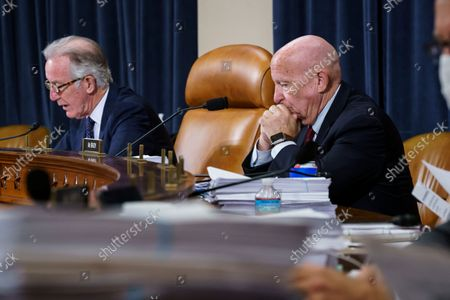 House Ways and Means Committee Chairman Richard Neal, D-Mass., left, and Rep. Kevin Brady, R-Texas, the ranking member, right, make opening statements as the tax-writing panel continues work on the Democrats' sweeping proposal for tax hikes on big corporations and the wealthy to fund President Joe Biden's $3.5 trillion domestic rebuilding plan, at the Capitol in Washington