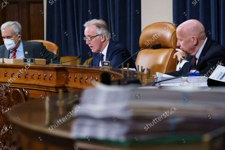 House Ways and Means Committee Chairman Richard Neal, D-Mass., center, flanked by Rep. Lloyd Doggett, D-Texas, left, and Rep. Kevin Brady, R-Texas, the ranking member, right, make opening statements as the tax-writing panel continues work on the Democrats' sweeping proposal for tax hikes on big corporations and the wealthy to fund President Joe Biden's $3.5 trillion domestic rebuilding plan, at the Capitol in Washington