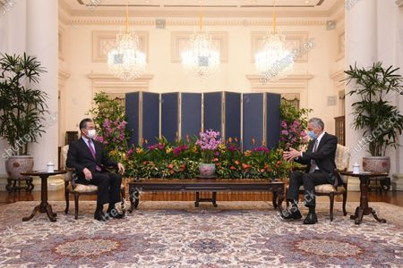 Stock Image of (210914) - SINGAPORE, Sept. 14, 2021 (Xinhua) - Singaporean Prime Minister Lee Hsien Loong meets with visiting Chinese State Councilor and Foreign Minister Wang Yi in Singapore, Sept. 14, 2021.