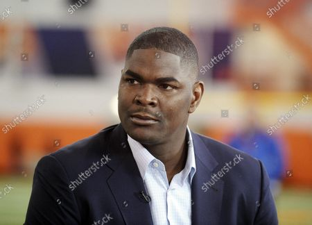 """Former NFL and Southern California receiver Keyshawn Johnson appears during the Clemson NCAA college football pro day in Clemson, S.C. In this era of racial reckoning, it is not only appropriate but significant that the stories of NFL trailblazers be told. Johnson, the 1997 top overall draft pick by the New York Jets and now host of ESPN's morning program, has done so. Collaborating with Bob Glauber, the Newsday columnist and 2021 recipient of the Bill Nunn Jr. Award by the Pro Football Writers of America for outstanding long-time reporting, Johnson has authored """"Forgotten First"""