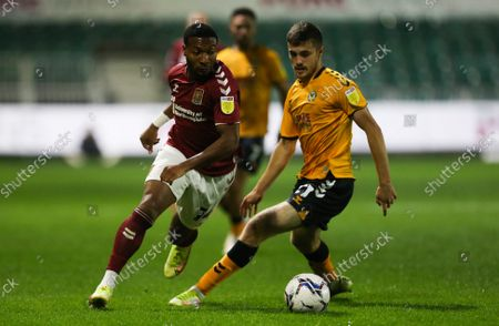 Stock Picture of Lewis Collins of Newport County challenges Ali Koiki of Northampton Town