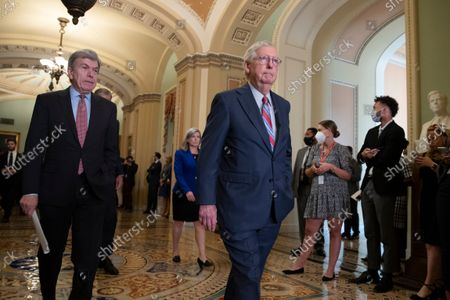 Stock Photo of Senate Minority Leader Mitch McConnell (R) and Republican Senator from Missouri Roy Blunt (L), walk up to participate in a news conference on Capitol Hill in Washington, DC, USA, 14 September 2021. Senate Republicans criticized the Biden administration's handling of the US withdrawal from Afghanistan.