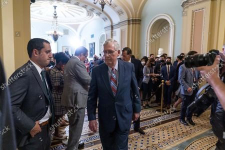 Senate Minority Leader Mitch McConnell, R-Ky., walks away after speaking with reporters as work continues on the Democrats' Build Back Better Act, massive legislation that is a cornerstone of President Joe Biden's domestic agenda, at the Capitol, in Washington