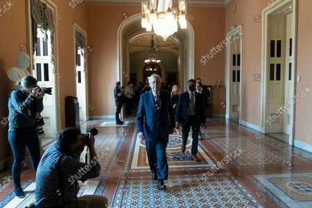 Senate Minority Leader Mitch McConnell, R-Ky., walks to his office after speaking with reporters as work continues on the Democrats' Build Back Better Act, massive legislation that is a cornerstone of President Joe Biden's domestic agenda, at the Capitol, in Washington