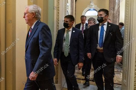 Senate Minority Leader Mitch McConnell, R-Ky., walks to a news conference as work continues on the Democrats' Build Back Better Act, massive legislation that is a cornerstone of President Joe Biden's domestic agenda, at the Capitol, in Washington