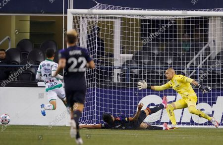 Santos Laguna goalkeeper Gibran Lajud, right, reacts as a shot by Seattle Sounders forward Raul Ruidiaz, second from right, goes wide during the first half of a Leagues Cup soccer semifinal, in Seattle