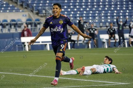 Seattle Sounders forward Raul Ruidiaz celebrates after he scored a goal past Santos Laguna midfielder Carlos Orrantia, right, during the second half of a Leagues Cup soccer semifinal, in Seattle. The Sounders won 1-0