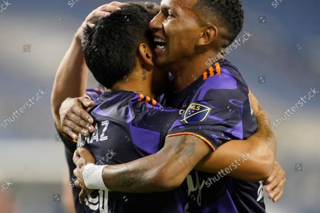 Stock Photo of Seattle Sounders forward Raul Ruidiaz, left, is hugged by midfielder Leo Chu after Ruidiaz scored against Santos Laguna during the second half of a Leagues Cup soccer semifinal, in Seattle. The Sounders won 1-0