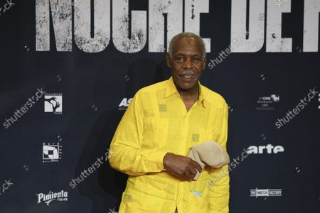 """Stock Image of American actor Danny Glover poses for the photographers during the red carpet premiere of the Mexican film """"Noche de Fuego"""" or Fire Night, in Mexico City"""