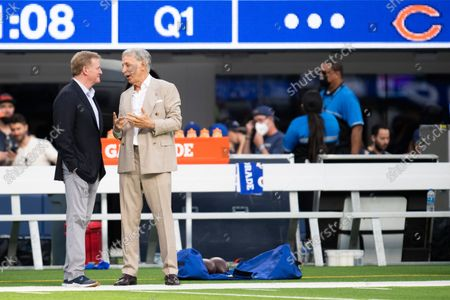 Los Angeles Rams owner Stan Kroenke, right, and National Football League commissioner Roger Goodell chat before an NFL football game between the Chicago Bears and the Los Angeles Rams, in Inglewood, Calif