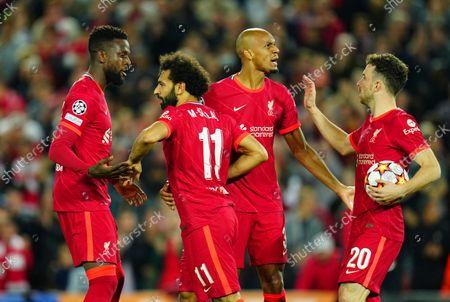 Divock Origi of Liverpool congratulates Mohamed Salah after his goal made the score 2-2