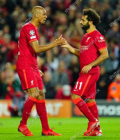 Fabinho of Liverpool congratulates Mohamed Salah after his goal made the score 2-2