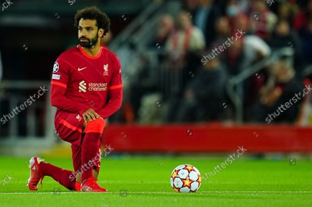 Mohamed Salah of Liverpool takes the knee