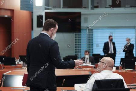 Jens Spahn (L), Federal Minister for Health, and Peter Altmaier (R), Federal Minister for Economic Affairs and Energy, speak with each other at the beginning of the weekly cabinet meeting in Berlin, Germany, 15 September 2021. Germany is scheduled to hold parliamentary elections on 26 September that will make way for the creation of a new government and the appointment of a new chancellor.