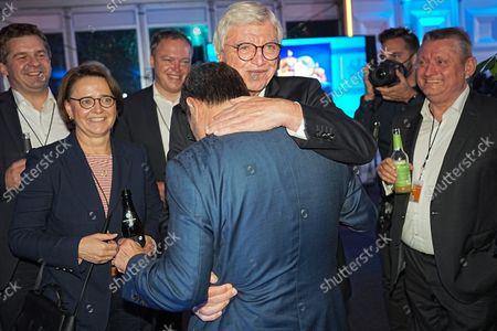 Hessian Prime Minister Volker Bouffier (M) hugs Chancellor candidate Armin Laschet (both CDU) after the TV discussion. Hermann Gröhe on the right. The chancellor candidates from Alliance 90/Grüne, CDU and SPD, Bärbock, Laschet, Scholz met in a first TV discussion at RTL and ntv.