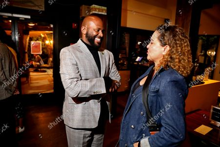"""Assemblyman Mike Gipson (D-Carson), left, and Wendy Bruget, of Los Angeles, attend a California recall election for Governor Gavin Newsom watch party hosted by the African American Voter Registration, Education and ParticipationProject (AAVREP) at Post & Beam on Tuesday, Sept. 14, 2021 in Los Angeles, CA. The AAVREP has been encouraging Blackvoterstocast a""""No""""voteby returning their recall ballots immediately in the mailforthe recall election of Governor Gavin Newsom. (Gary Coronado / Los Angeles Times)"""