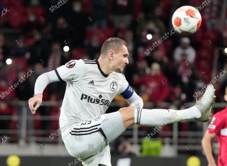 Legia's Artur Jedrzejczyk kicks the ball during the Europa League Group C soccer match between Spartak Moscow and Legia Warsaw at the Otkritie Arena, in Moscow, Russia