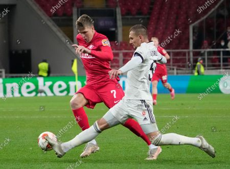 Spartak's Aleksandr Sobolev, left, challenge for the ball with Legia's Artur Jedrzejczyk during the Europa League Group C soccer match between Spartak Moscow and Legia Warsaw at the Otkritie Arena, in Moscow, Russia