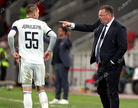 Legia Warsaw's head coach Czeslaw Michniewicz (R) gives instructions to Artur Jedrzejczyk (L) during the UEFA Europa League group C soccer match between Legia Warsaw and FC Spartak Moscow at the Spartak Stadium in Moscow, Russia, 15 September 2021.