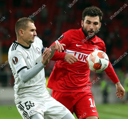 Artur Jedrzejczyk (L) of Legia Warsaw in action against Georgi Dzhikiya (R) of Spartak Moscow during the UEFA Europa League group C soccer match between Legia Warsaw and FC Spartak Moscow at the Spartak Stadium in Moscow, Russia, 15 September 2021.