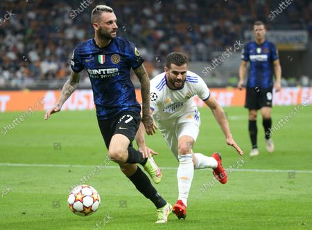 Inter Milan's Marcelo Brozovic (L) challenges for the ball Real Madrid's Nacho Fernandez during the UEFA Champions League group D soccer match between FC Inter and Real Madrid at Giuseppe Meazza stadium in Milan, Italy, 15 September 2021.