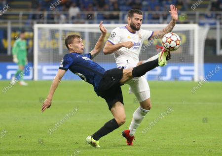 Inter Milan's Nicolo Barella (L) challenges for the ball Real Madrid's Nacho Fernandez during the UEFA Champions League group D soccer match between FC Inter and Real Madrid at Giuseppe Meazza stadium in Milan, Italy, 15 September 2021.