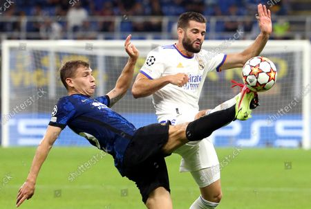 Inter's Nicolo Barella (L) in action against Real Madrid's Nacho Fernandez during the UEFA Champions League group D soccer match between FC Inter and Real Madrid at Giuseppe Meazza stadium in Milan, Italy, 15 September 2021.