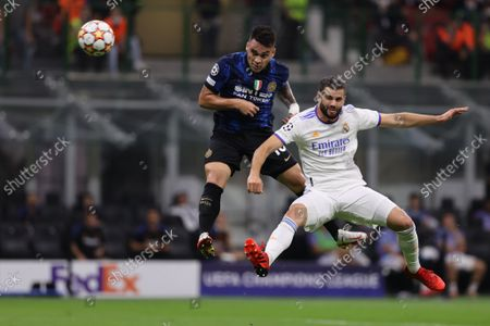 Lautaro Martinez of FC Internazionale fights for the ball against Nacho Fernandez of Real Madrid CF
