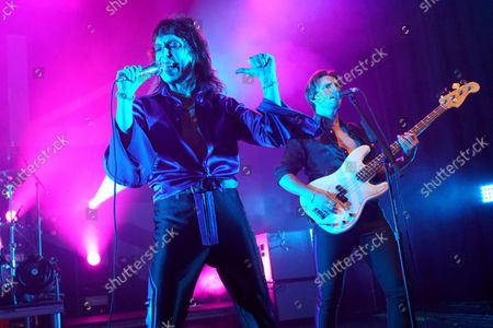 Luke Spiller, left, and Jed Elliott of The Struts performs on the 'Strange Days are Over Tour' at the Riviera Theatre, in Chicago