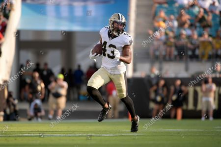 New Orleans Saints free safety Marcus Williams (43) runs after intercepting a pass during the second half of an NFL football game against the Green Bay Packers, in Jacksonville, Fla