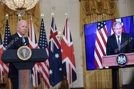 President Joe Biden participates is a virtual press conference on national security initiative on September 15, 2021 in the East Room of the White House in Washington, DC. President Biden is joined virtually by Prime Minister Scott Morrison of Australia and Prime Minister Boris Johnson of the United Kingdom.