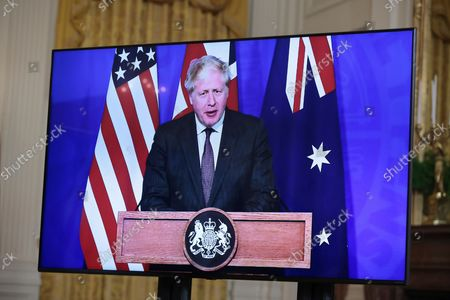 President Joe Biden participates in a virtual press conference on national security initiative on September 15, 2021 in the East Room of the White House in Washington, DC. President Biden is joined virtually by Prime Minister Scott Morrison of Australia and Prime Minister Boris Johnson of the United Kingdom.