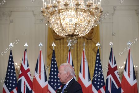 President Joe Biden participates is a virtual press conference on national security initiative on September 15, 2021 in the East Room of the White House in Washington, DC. President Biden is joined virtually by Prime Minister Scott Morrison of Australia and Prime Minister Boris Johnson of the United Kingdom