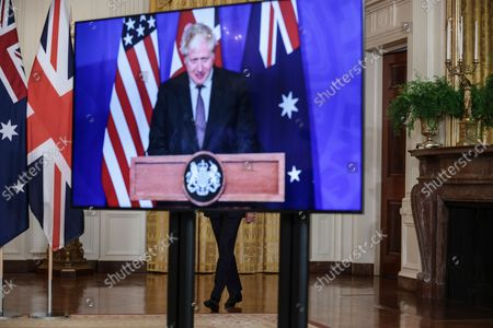 President Joe Biden arrives during is a virtual press conference on national security initiative on September 15, 2021 in the East Room of the White House in Washington, DC. President Biden is joined virtually by Prime Minister Scott Morrison of Australia and Prime Minister Boris Johnson of the United Kingdom.