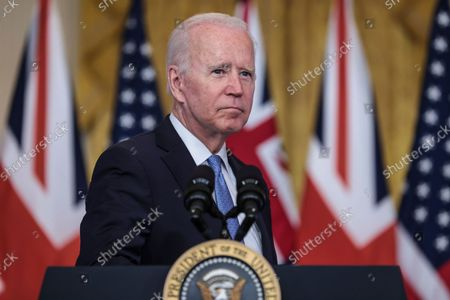 President Joe Biden pauses as he delivers remarks about a national security initiative on September 15, 2021 in the East Room of the White House in Washington, DC. President Biden is joined virtually by Prime Minister Scott Morrison of Australia and Prime Minister Boris Johnson of the United Kingdom.