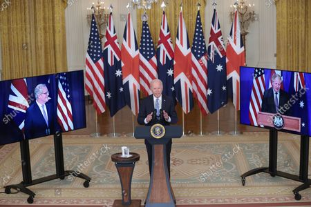 """President Joe Biden, flanked by Prime Minister Scott Morrison of Australia, left, and Boris Johnson of the United Kingdom, right, delivers remarks about a national security initiative on September 15, 2021 in the East Room of the White House in Washington, DC. The leaders announced the creation of an enhanced trilateral security partnership called """"AUKUS"""" - Australia, the United Kingdom, and the United States."""