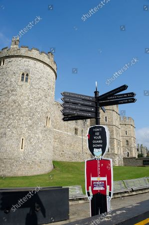 Covid-19 Don't Let Your Guard down signs remain outside Windsor Castle. The number of positive Covid-19 cases in the Royal Borough of Windsor per 100,000 people in the seven days up to and including 10 September compared with the week before are 345, down from 387. Under the latest Government Plan A, unvaccinated people will be encouraged to be jabbed, vaccines will be offered to 12 to 15 year old children and booster jabs are to be rolled out to over 50s