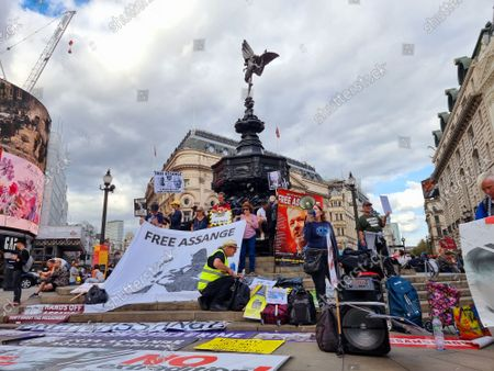 Free Julian Assange. Hundreds of Julian Assange supporters and activist gathered in London to protest against his extradition case and demand he be released.