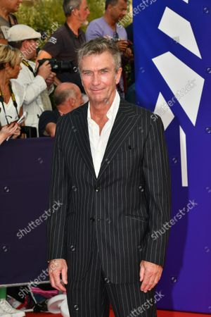 Stock Image of Philippe Caroit is waiting for the New Hollywood Prize And Flag Day premiere during the 47th Deauville American Film Festival on September 04, 2021 in Deauville, France.