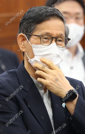 Stock Photo of Shigeru Omi, Japan Community Health Care Organization president and a member of the government panel for COVID-19  listens to a question at Upper House's health, labor and welfare committee session at the National Diet in Tokyo on Thursiday, September 16, 2021.