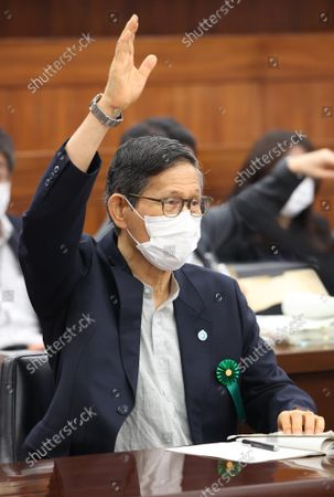 Shigeru Omi, Japan Community Health Care Organization president and a member of the government panel for COVID-19  raises his hand to answer a question at Upper House's health, labor and welfare committee session at the National Diet in Tokyo on Thursiday, September 16, 2021.