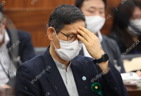 Shigeru Omi, Japan Community Health Care Organization president and a member of the government panel for COVID-19  puts his hand on his forehead as he listens to a question at Upper House's health, labor and welfare committee session at the National Diet in Tokyo on Thursiday, September 16, 2021.