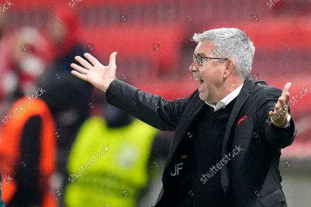 Berlin's head coach Urs Fischer gestures during the Europa Conference League group E soccer match between Slavia Praha and FC Union Berlin at the Sinobo stadium in Prague, Czech Republic